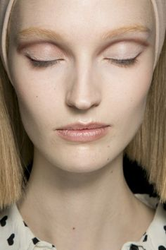 at Marc Jacobs, François Nars and his team defined the eyes in a harmony of nudes and beiges, drawing a taupe line into the creases of the lids.