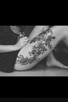Leg flower tattoo