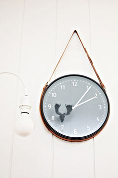 hang a clock from a belt.  it just looks so much cooler this way.