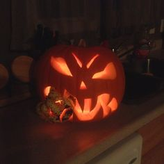 Last years pumpkin carving. Very easy to do, just cut a gourd in half, carve it and fit it into the mouth of your larger carved pumpkin :)