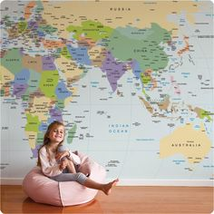 Get the kids excited about seeing the world with this awesome removable world map wallpaper #familytravel