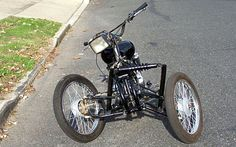Front Suspension - another tilting reverse trike - very simple design - but it uses a single shock (not ideal) and looks pretty ugly as a result