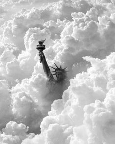 The Statue of Liberty peeking out from the clouds, New York City, NY, USA. City Photography, Canon Photography, Lifestyle Photography, Image New, Black And White Aesthetic, Concrete Jungle, Our Lady, Great Photos, Land Scape