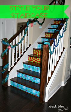 Christmas-ify your staircase with wrapping paper and double-sided tape! Genius! | Fresh Idea Studio