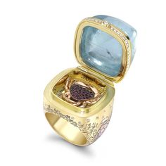 Theo Fennell Hermitage opening ring in yellow, rose and white gold with a 64.53ct cabochon aquamarine, rubies and diamonds.