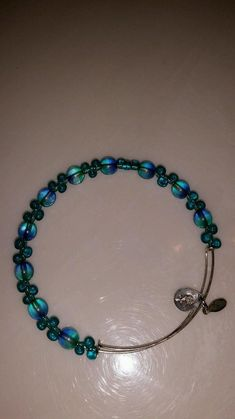 983143391 This is a beautiful Alex and Ani bracelet in the color teal. It has silver