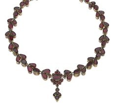 GOLD AND GARNET NECKLACE, EARLY 19TH CENTURY Designed as a graduated series of foliate motifs set with foil backed flat-cut garnets, length approximately 420mm.