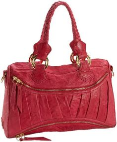 """The Fuschia Asher is stunning.  I want to point out that the color is not as bright as it is in the online photos. The true color is closer to a raspberry shade and not as pink as the photos suggests. Still an eye catching bag with wonderful leather. One of my kids call this the """"Valentine Bag"""" because of the color and the fact that the leather that holds the handles down is stitched resembles hearts."""