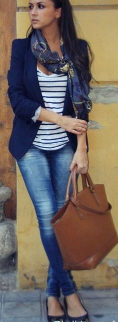 This blue blazer, blue and white striped tee and blue jeans is set off by a neutral bag.
