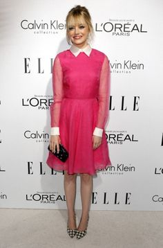 Emma Stone wearing Salvatore Ferragamo Fall 2011 Houndstooth Large Print Pumps, Valentino Fall 2012 Studded Clutch and Valentino Resort 2013 Pink Longsleeve Dress.