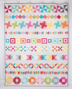 gorgeous scrappy row quilt, by amanda jean nyberg, from the crazy mom quilts blog (with a chance to win her craftsy class)