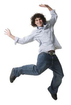 Imagen libre de derechos: Portrait of a teenage boy jumping…