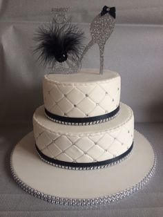Quilted cake with diamanté embellishment and show topper