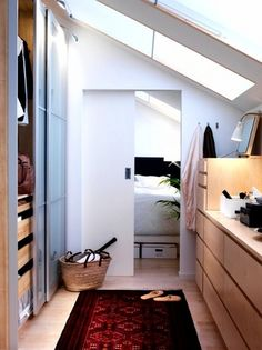 Increase head height and light in loft closet with well placed rooflights. www.methodstudio.london