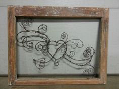 Barbed wire heart in old window frame $45
