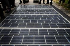 Each of the tiles is made from glass and is designed to be a 'more attractive way' to introduce solar panels to more homes