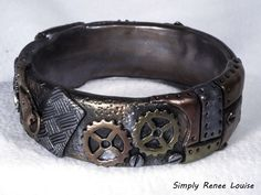 Steampunk bracelet cuff made with polymer clay and mica powders. By Simply Renee Louise.
