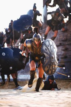 Brad Pitt depicting the famous warrior Achilles storming the beaches of Troy in the movie adaption of the Trojan War 'Troy' starring alongside Aussie Eric Banner. Troy Film, Troy Movie, Movie Scene, Troy Achilles, Best Action Movies, Greek Warrior, Trojan War, Films Cinema, Ancient Greece