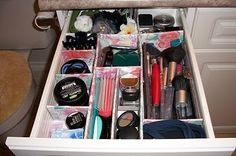 Make your own Drawer Dividers!  Cardboard, Fabric, & Hot Glue.  What a great way to make a perfect home for everything!