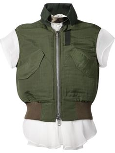 Military style vest over white t-shirt.