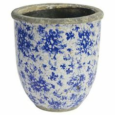 "Showcasing a crackled white and blue floral motif, this country-chic ceramic pot adds a rustic touch to your entryway console table or living room mantel.  Product: PotConstruction Material: CeramicColor: White and blueFeatures:  Floral motifCrackled finishDimensions: 9"" H x 7.5"" Diameter"