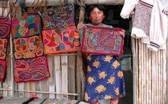 beautiful molas made by Cuna Indians on an island just off the Panamanian coast.  Designs are made by exposing the layers of cloth that were sewn together