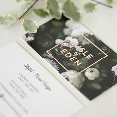 Aisle of Eden business card design by Leah Hill Creative. Rose gold foil complimented the strong floral background on linen stock.