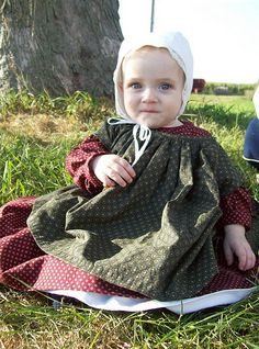 Baby cap and dress, plus pinafore, 17th-18th century.