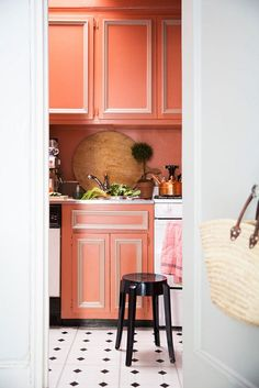 coral peach cabinets, pantone blooming dahlia, salmon pink