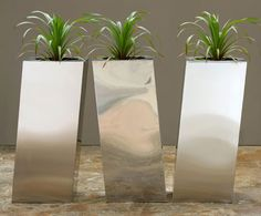 Stainless steel planters for a very modern space