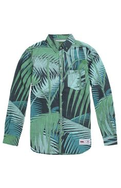 A PacSun.com Online Exclusive! PacSun presents the Vandal Deep Jungle Palms Woven Shirt for men. This leafy men's button up shirt comes with a colorful print and a Vandal patch sewn on bottom.   	Allover multi color print button up shirt 	Vandal patch sewn on bottom 	Chest pocket 	Medium spread collar 	Button front 	Long sleeves 	Straight yoke 	Regular fit 	Machine washable 	100% cotton 	Imported