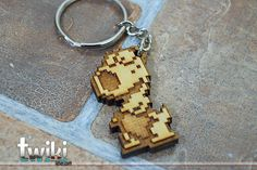Laser cut and engraved Mario Bros 8bit Birdo wood keyring. By TwikiConcept on Etsy