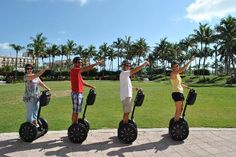 Hmm. Interesting pose. Not sure what inspired it. Maybe pointing out what a beautiful Day it is in Palm Beach, Florida? Palm Beach Segway Tours is the #1 attraction in this destination!
