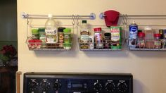 Ikea baskets, rods and hooks perfect as spice racks above your stove. Great for small kitchen without a lot of storage.