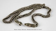 Silver chain with clasps in the form of animal heads [source]. Culture: Slavic(West Slavs) Found in: Borucin, Poland Timeline: first half of 11th century