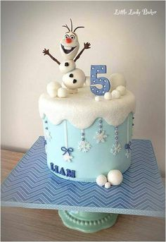 Olaf cake - sparkling snow and snowballs, hanging snowflakes.