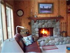 Fireplace of rustic cabin, cottage or lodge