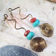whimsical wire  http://www.etsy.com/listing/79652459/joy-of-life-earrings