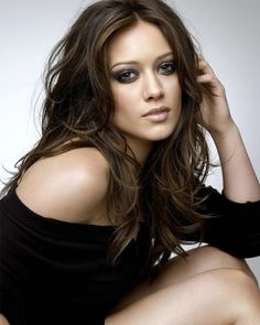 Brunette Hilary Duff. The waves make it messy but sexy. It's these types of hair styles that make me wish i didn't chop off my hair. Oh well, I couldn't do this anyway, so I'll just dream of having hair like this