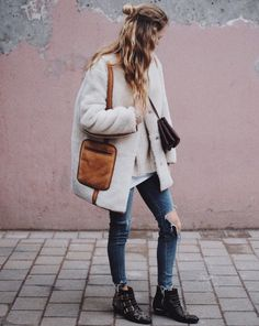 Shearling coat, layered knits, a crossbody bag, ripped-knee jeans, and Chloé studded boots