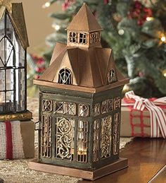 Ellington Tealight Lantern Handcrafted of Metal and Textured Glass Plow & Hearth http://www.amazon.com/dp/B00NY6DWYI/ref=cm_sw_r_pi_dp_9zfEub142B46Y