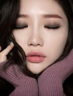 Young, Asian Female. Nice and great basic eyeshadow application
