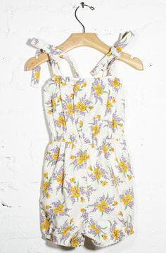 use this tutorial to make one like it... http://sewingin-nomansland.blogspot.com/2011/02/retro-romper-tutorial.html