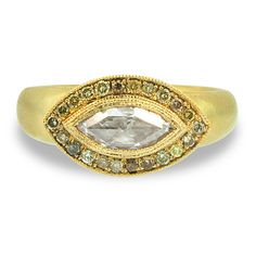 Marquis Diamond Halo Ring    14k yellow gold marquis diamond halo engagment ring with accent champagne coloured diamonds      $3800