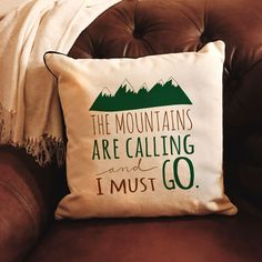 """""""The Mountains are Calling and I must go"""" green and brown Pillow Cover ads a touch of charm to your decor. Pillow cover measures approximately 15.5"""" x 15.5"""" and is a high quality 10 oz. canvas. Fits a"""
