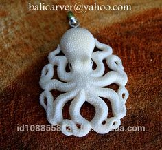 Octopus pendant made from carved buffalo bone Free by BaliCarver Octopus Jewelry, Octopus Art, Bone Crafts, Clay Crafts, Dremel, Bone Carving, Skull And Bones, Resin Jewelry, Jewellery