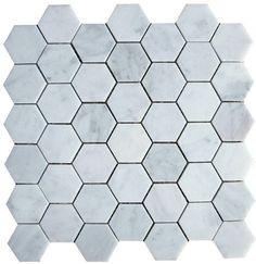 """Bianco+White+Carrara+Marble+Honed+Mesh+Mounted+Tile+in+2x2+Hexagon+Tile+format+-+Bianco+White+Carrara+marble+2+in.+x+2+in.+hexagon+mosaic+tile+is+a+perfect+mosaic+tile+for+any+interior+wall+or+floor+covering+project.+This+white+Carrara+marble+tile+come+in+the+form+of+a+12""""+x+12""""+mesh+mounted+mosaic+sheet,+which+approximately+covers+1+sqft.+This+Carrara+marble+mosaic+tile+has+36+chips+of+1""""+x+1""""+hexagon+set+a+honeycomb+format.+This+tile+finish+is+honed+that+makes+it+muted+"""