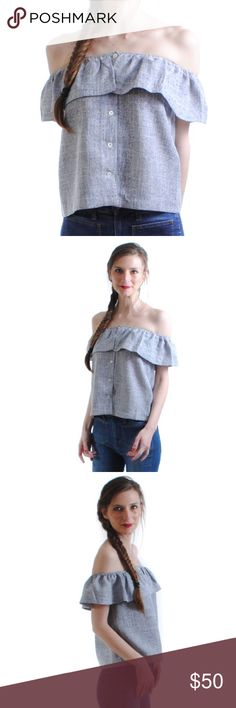 Lyndsay Top Show some shoulder with this simple yet beautiful blue/grey top. This looser fit is perfectly paired with fitted cropped jeans or denim shorts. Bring out your inner minimalistic fashion maven in our favorite top!  56.5% Polyester, 43.5% Viscose Blue/grey stop with ruffle neck / sleeves and button detail.  size + fit: Model is 5ft 9in and wearing a size XS. Top is roomy and light and fit is true to size. Tops Blouses