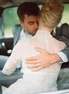 Love this...great shot of the dress and the grooms ring