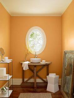 I like this shade.  It's still orange, but lighter.  benjamin moore august morning 2156-40